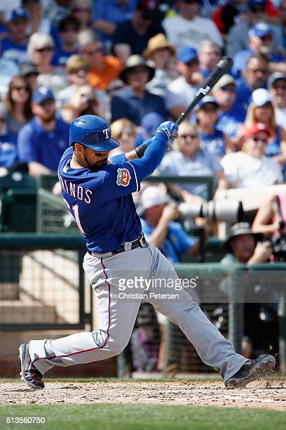 Robinson Chirinos of the Texas Rangers bats against the Kansas City Royals during the cactus leauge spring training game at Surprise Stadium on March...