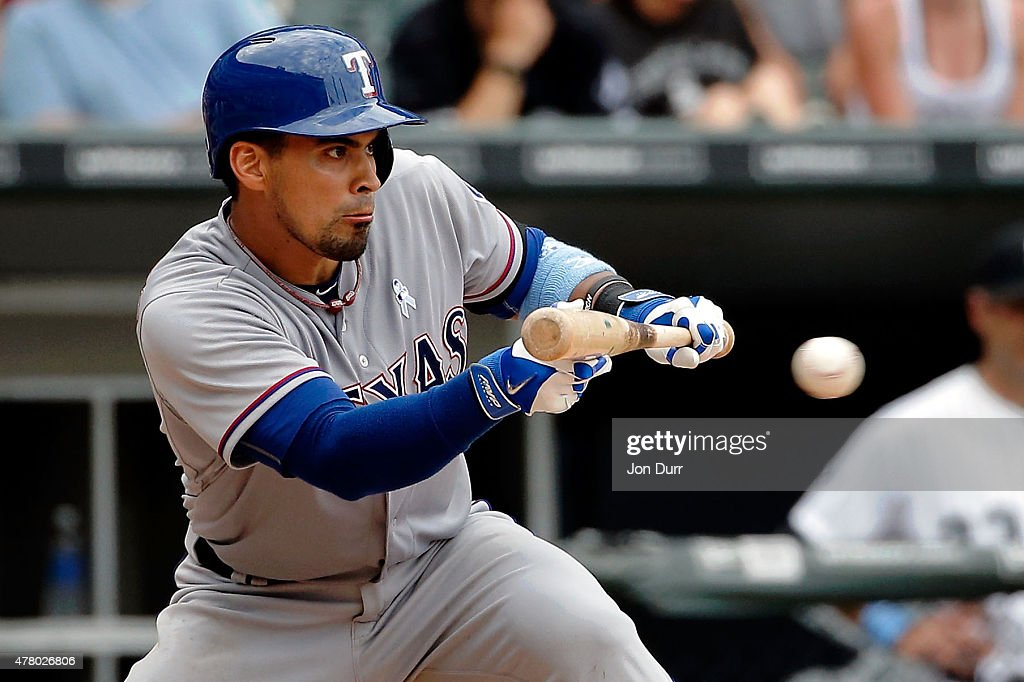 Robinson Chirinos #61 of the Texas Rangers bunts against the Chicago White Sox during the eleventh inning at U.S. Cellular Field on June 21, 2015 in Chicago, Illinois. The Chicago White Sox won 3-2 in eleven innings