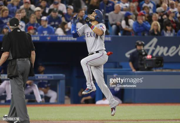 Robinson Chirinos of the Texas Rangers celebrates after hitting a solo home run in the second inning during MLB game action against the Toronto Blue...