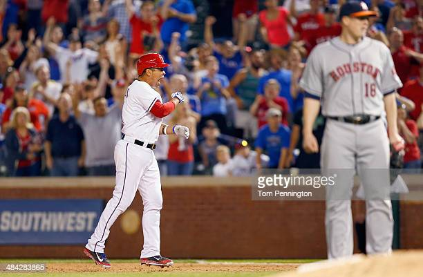 Robinson Chirinos of the Texas Rangers celebrates after hitting the game winning RBI against the Houston Astros in the bottom of the twelfth inning...