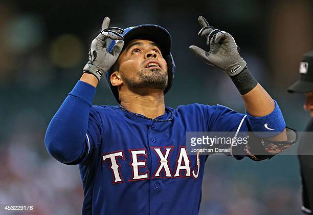 Robinson Chirinos of the Texas Rangers celebrates hitting a solo home run in the 2nd inning against the Chicago White Sox at US Cellular Field on...