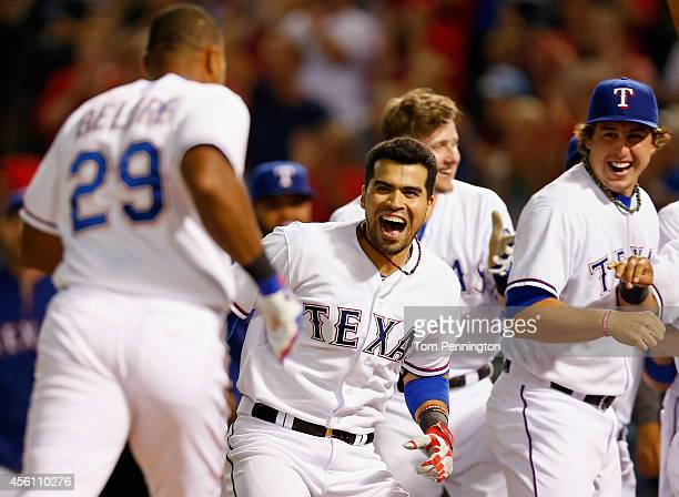 Robinson Chirinos of the Texas Rangers celebrates with Adrian Beltre of the Texas Rangers at home plate after Beltre hit the game winning walkoff...