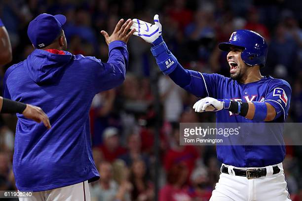 Robinson Chirinos of the Texas Rangers celebrates with Hanser Alberto of the Texas Rangers after hitting a home run against the Tampa Bay Rays in the...