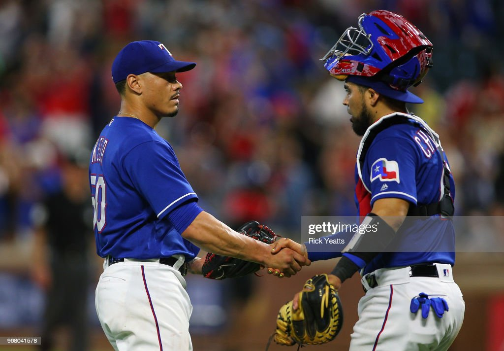 Robinson Chirinos #61 of the Texas Rangers congratulates Keone Kela #50 for closing out the game in the ninth inning for the win against the Oakland Athletics at Globe Life Park in Arlington on June 5, 2018 in Arlington, Texas.