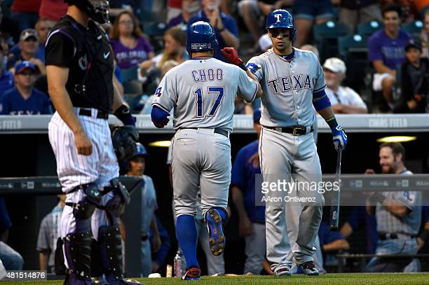 Robinson Chirinos of the Texas Rangers daps ShinSoo Choo of the Texas Rangers after his leadoff home run in the fourth inning during a inter league...