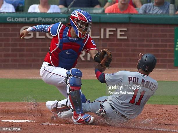 Robinson Chirinos of the Texas Rangers goes to tag out Jorge Polanco of the Minnesota Twins out at home in the fourth inning of a baseball game at...