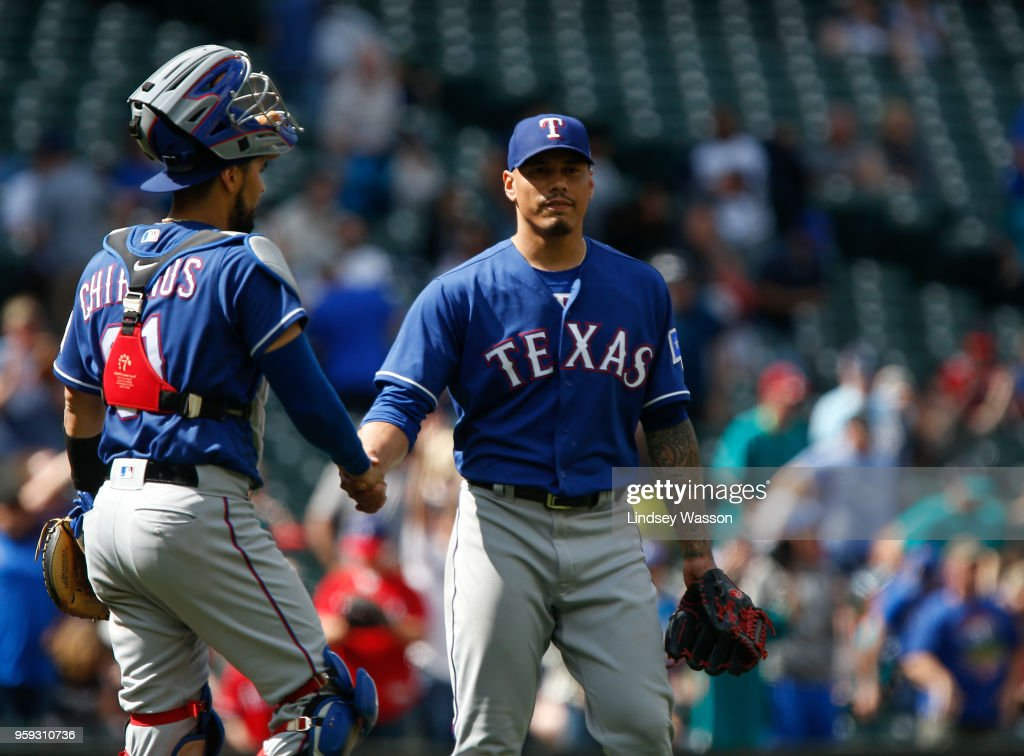 Robinson Chirinos #61 of the Texas Rangers greets Keone Kela #50 after he secured the win against the Seattle Mariners at Safeco Field on May 16, 2018 in Seattle, Washington. The Texas Rangers beat the Seattle Mariners 5-1.