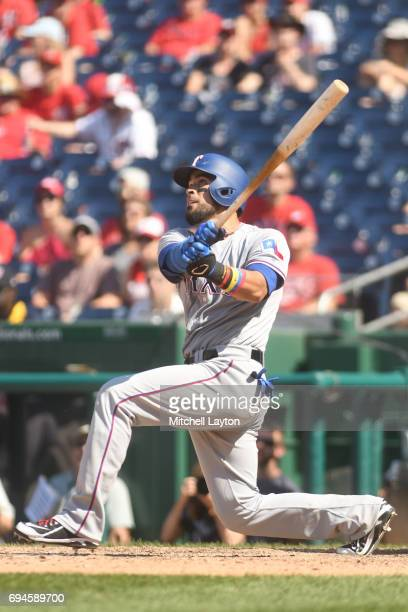Robinson Chirinos of the Texas Rangers hits a game winning three run home run in the eleventh inning during a baseball game against the Washington...