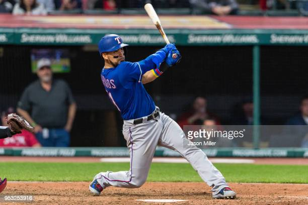 Robinson Chirinos of the Texas Rangers hits a solo home run during the seventh inning against the Cleveland Indians at Progressive Field on April 30...