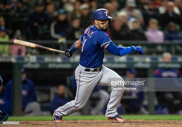 Robinson Chirinos of the Texas Rangers hits a tworun double off of relief pitcher Juan Nicasio of the Seattle Mariners scoring Jurickson Profar of...
