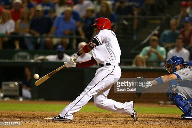Robinson Chirinos of the Texas Rangers hits a walkoff home run in the ninth inning during a game against the Los Angeles Dodgers at Globe Life Park...