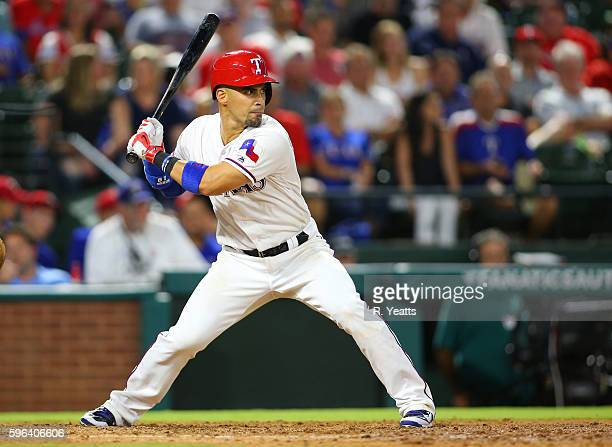 Robinson Chirinos of the Texas Rangers hits in the sixth inning against the Oakland Athletics at Globe Life Park in Arlington on August 16 2016 in...