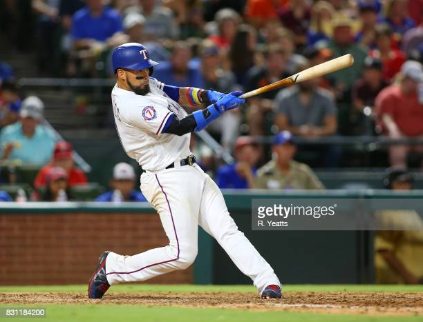 Robinson Chirinos of the Texas Rangers hits in the sixth inning against the Baltimore Orioles at Globe Life Park in Arlington on July 28 2017 in...