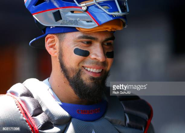 Robinson Chirinos of the Texas Rangers in action against the New York Yankees during a game at Yankee Stadium on June 24 2017 in the Bronx borough of...