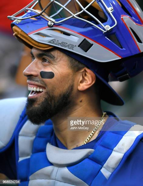 Robinson Chirinos of the Texas Rangers in the dugout before playing the Los Angeles Angels of Anaheim at Angel Stadium on June 2 2018 in Anaheim...