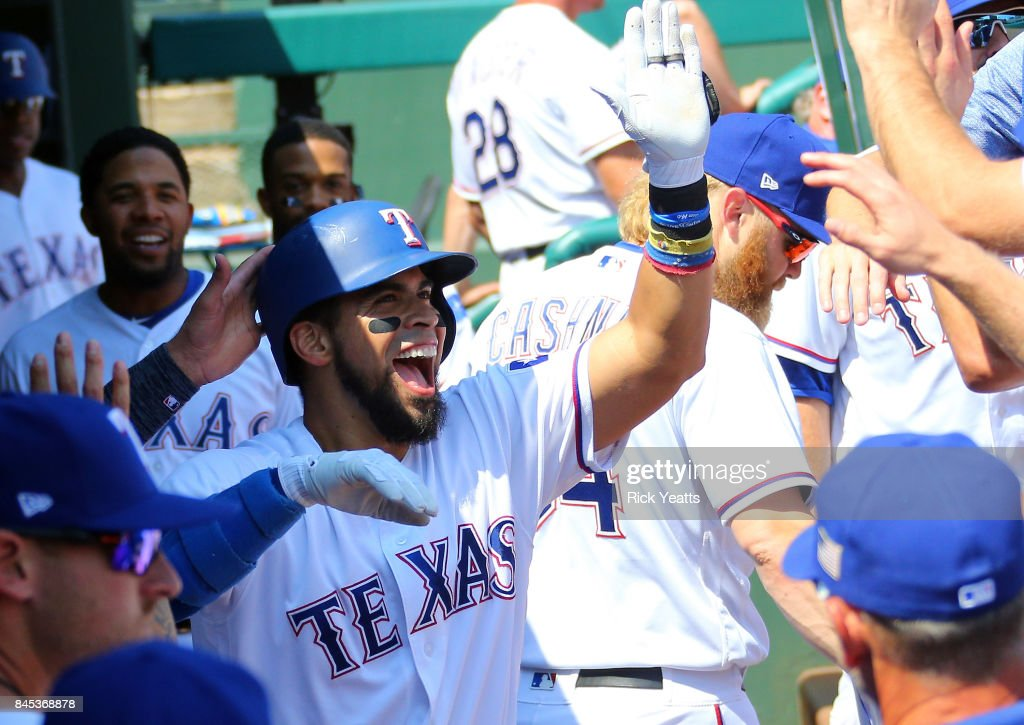 Robinson Chirinos #61 of the Texas Rangers is congratulated in the dugout after hitting a home run in the second inning against the New York Yankees at Globe Life Park in Arlington on September 10, 2017 in Arlington, Texas.