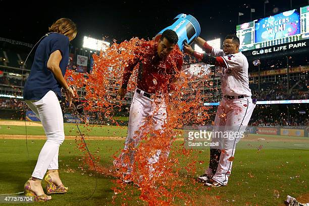 Robinson Chirinos of the Texas Rangers is dunked after hitting a walkoff home run in the ninth inning during a game against the Los Angeles Dodgers...