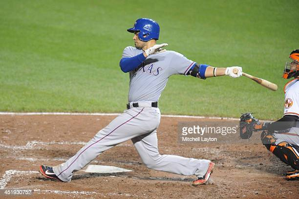 Robinson Chirinos of the Texas Rangers takes a swing during a baseball game against the Baltimore Orioles on June 30 2014 at Oriole Park at Camden...
