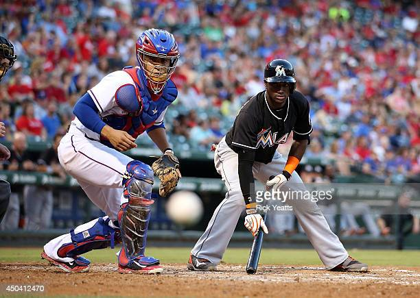 Robinson Chirinos of the Texas Rangers watches the ball go foul hit by Adeiny Hechavarria of the Miami Marlins in the third inning at Globe Life Park...