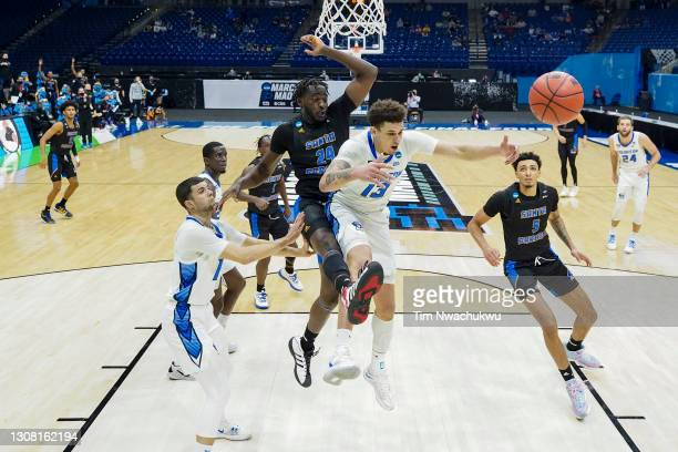 Robinson Idehen of the UC Santa Barbara Gauchos bumps Christian Bishop of the Creighton Bluejays during the first half in the first round game of the...