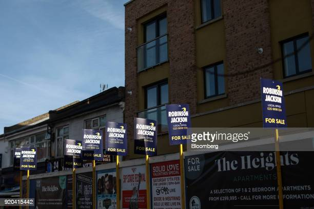 Robinson Jackson estate agency 'for sale' signs stand in the district of Catford in London UK on Friday Feb 16 2018 London's property market has...