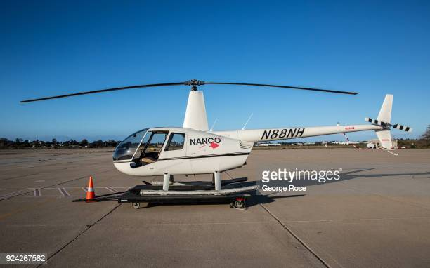 Robinson RH44 helicopter is parked at Santa Barbara Airport on February 23 in Santa Barbara California A combined series of natural disasters the...