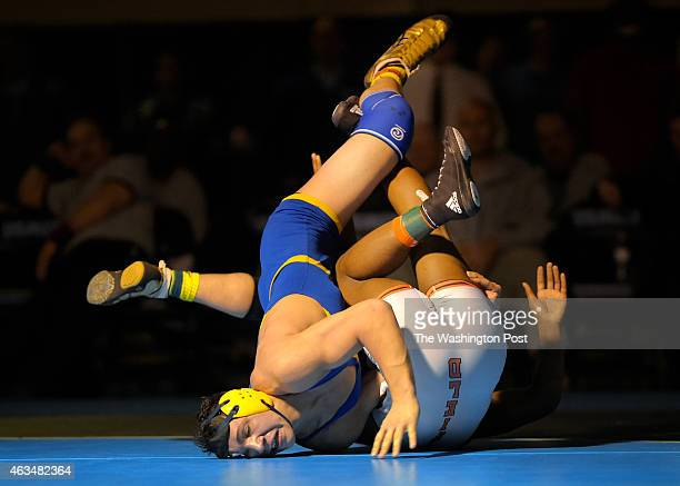 Robinson's Cole DePasquale left grapples with Hayfield's Antonio Agee in a 182 pound match that DePasquale won in sudden death overtime during the...