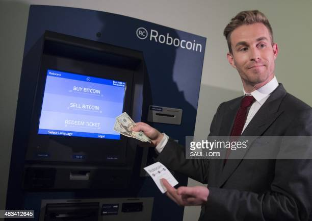 Robocoin CEO Jordan Kelley demonstrates how to buy and sell bitcoins during a demonstration of a Robocoin kiosk on Capitol Hill in Washington DC...