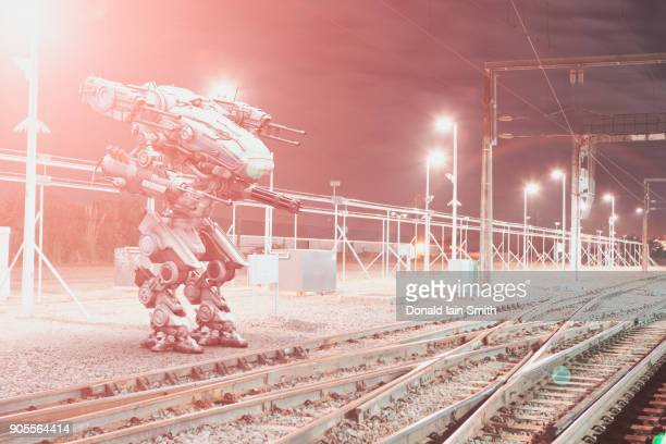 robot aiming guns at railroad tracks - weapon stock pictures, royalty-free photos & images