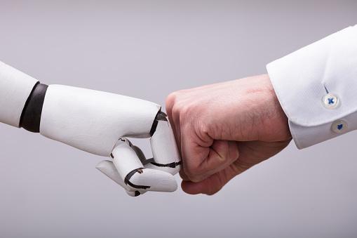 Robot And Human Hand Making Fist Bump 949223490