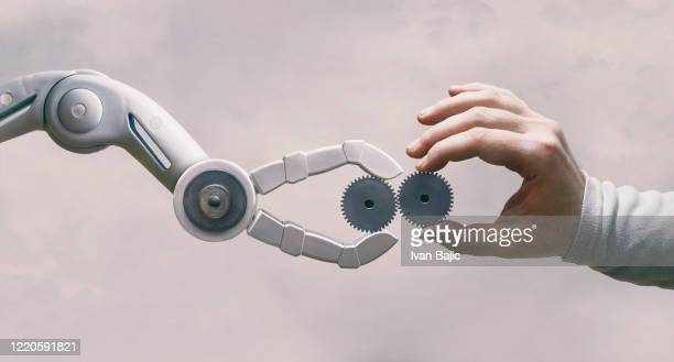 robot and human hand with gears - solutions stock pictures, royalty-free photos & images
