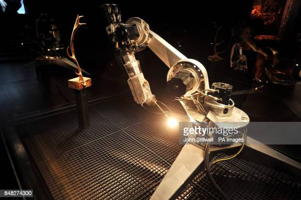 A robot arm designed by Conrad Shawcross that responded to the work of the artist Titian's paintings titled 'Diana and Callisto' 'Diana and Actaeon'...