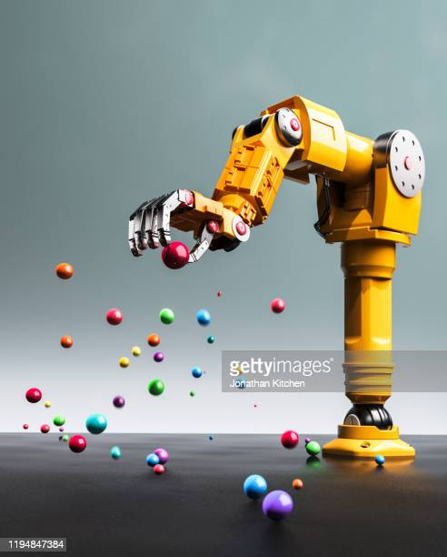 robot arm selection - artificial intelligence stock pictures, royalty-free photos & images