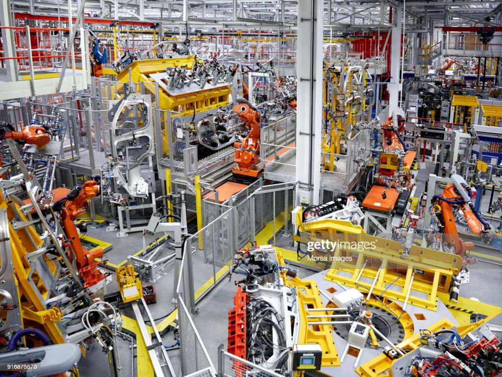 robot arms in a car manufacturing factory stock photo | getty images