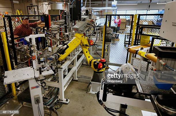 A robot assembles acrylic blender jars at the KTec Inc Blendtec factory in Orem Utah US on Wednesday March 26 2014 The Institute for Supply...