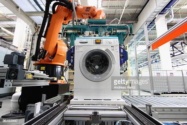 Robot assembles Washing Machines at the BSH Bosch Siemens Hausgeraetewerk Nauen consumer appliances factory, the world's third-largest appliance...