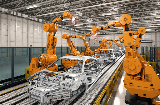robot assembly line in car factory 849023956