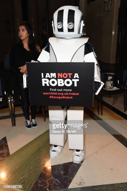 A robot attends the Pam Hogg front row during London Fashion Week September 2018 at The Freemason's Hall on September 14 2018 in London England
