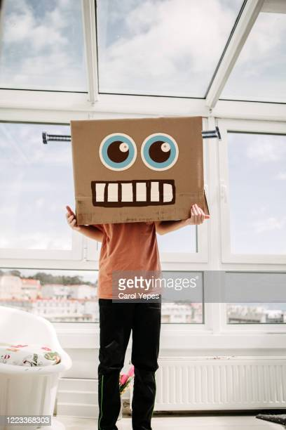 robot boy in cardboard box - mask cartoon characters stock pictures, royalty-free photos & images