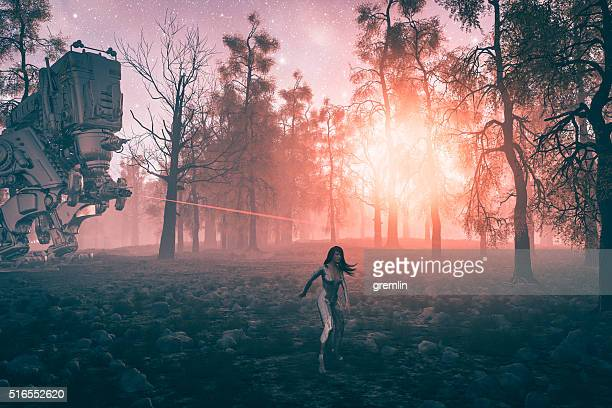 robot chasing astronaut in the forest - military invasion stock pictures, royalty-free photos & images