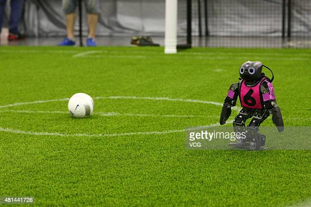 A robot competes in a RoboCup Soccer game during the 19th RoboCup World Competition and Symposium at Hefei International Conference Exhibition Center...