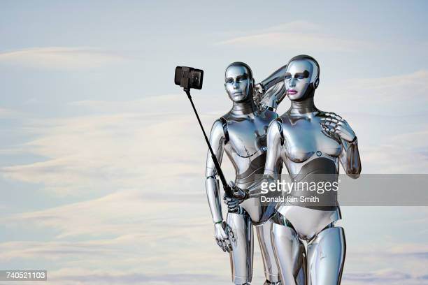 Robot couple posing for cell phone selfie