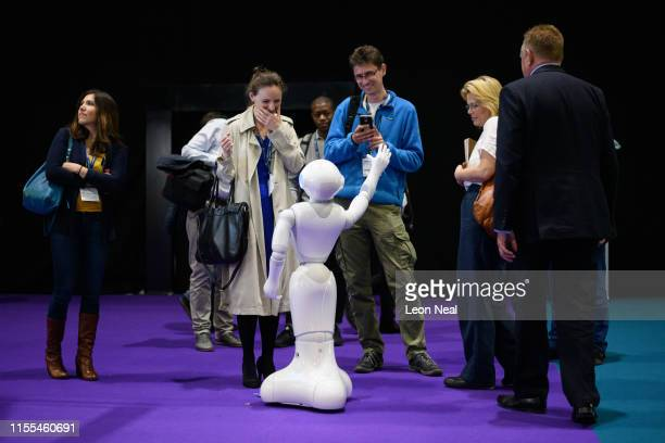 A robot created by the Cyberselves project interacts with visitors as it wanders through the exhibition space during the TechXLR8 event at ExCel on...