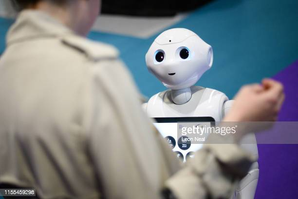 A robot created by the Cyberselves project wanders through the exhibition space during the TechXLR8 event at ExCel on June 12 2019 in London England...