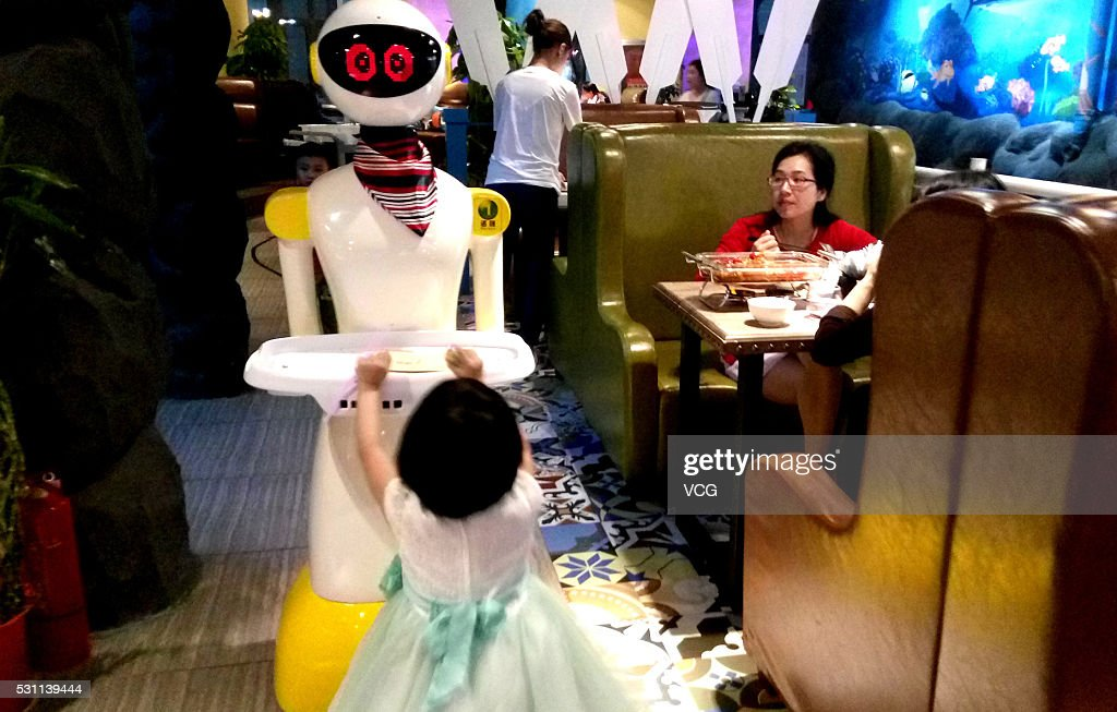 Service Robot Delivers Meals In Wuhan : News Photo
