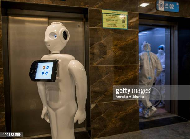"""Robot designed to assist Covid-19 patients operates in the Covid-19 ward of a hospital on December 5, 2020 in New Delhi, India. The """"Mitra"""" robot can..."""