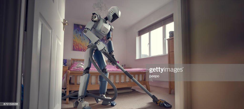 Robot faisant ménage nettoyage avec aspirateur : Photo