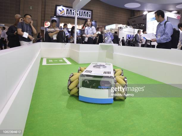 A robot equipped with Nabtesco Corporation's Mecanum wheel drive unit performs at the Japan Robot Week 2018 at Tokyo Big Sight Japan on October 17...