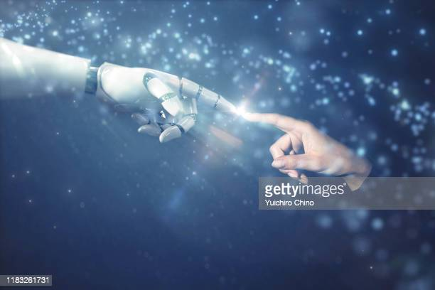 robot finger touching to human finger with emotional scene - menschlicher finger stock-fotos und bilder