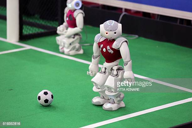 A robot from Iran's Qazvin Islamic Azad University takes part in a football match against German NaoTeam HTWK from the Leipzig United University...